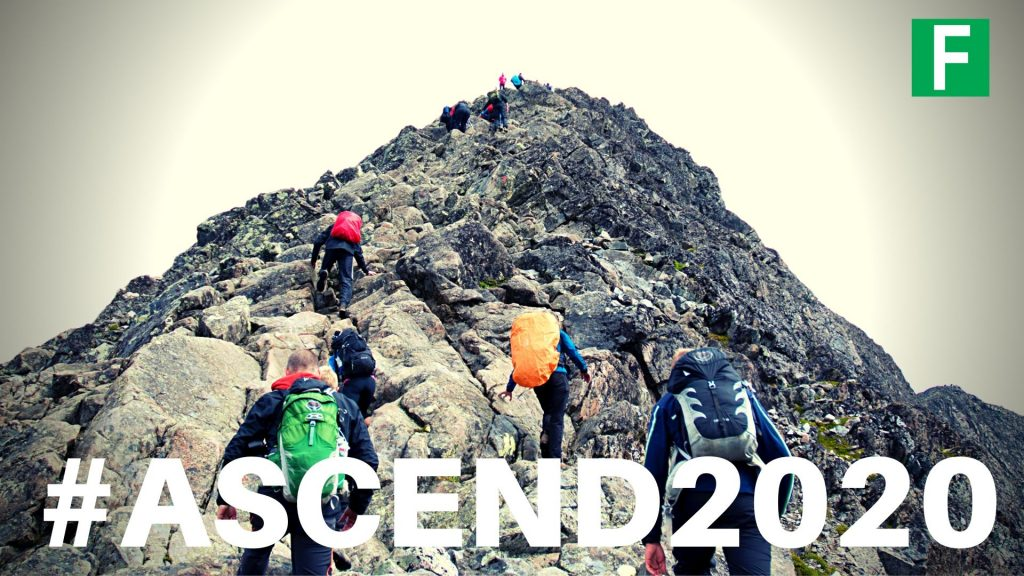 people climbing a mountain with the words ascend2020
